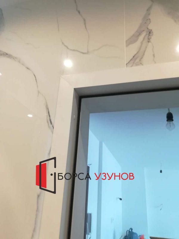 Обличаща каса за алуминиева врата в София от Узунов